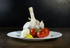 Free Tomatoes And Garlic In White Plate Royalty Free Stock Images - 70619459
