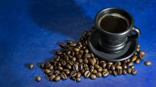 Free Cup Of Hot Coffee On The Old Blue Background Stock Photo - 70962270