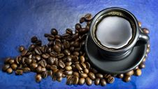 Free Cup Of Hot Coffee On The Old Blue Background Stock Photo - 70962280