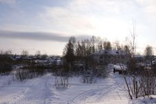 Village In A Winter Day Stock Photo