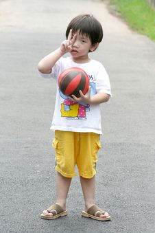 Kid Holding A Ball. Stock Photo