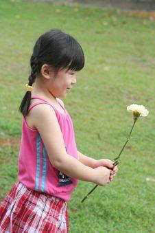 Free Girl Holding Flower. Stock Photo - 715600