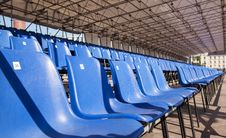 Free Plastic Blue Seats In A Stadium Royalty Free Stock Image - 71368906