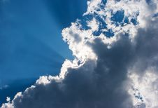 Sun S Rays Behind The Cloud Stock Photo