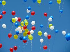 Free Bright Red, Yellow, Blue, And White Balloons Released Into A Blue Sky. Royalty Free Stock Image - 71993096