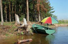 Free Boat Under A Umbrella Royalty Free Stock Image - 720196