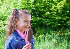 Smiling Girl Eating Ice Cream Stock Photos