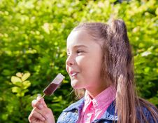 Free Girl Eating Ice Cream Outside Stock Images - 72511484