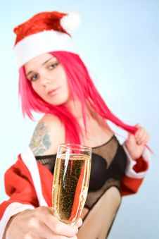 Attractive Mrs. Santa With Champagne Glass Stock Photos