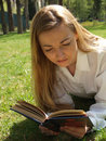 Free Woman Reading On The Grass Stock Images - 734214