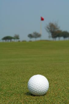 Free Golf Ball Near Flag Royalty Free Stock Image - 734026