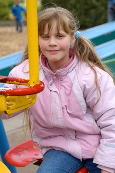Free Pretty Girl At The Playground Royalty Free Stock Images - 736499