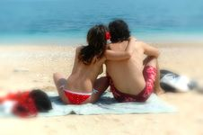 A Cute Couple Cuddles On An Italian Beach Royalty Free Stock Images