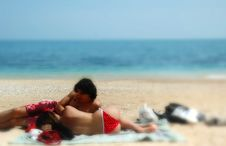 A Cute Couple Cuddles On An Italian Beach Stock Photo