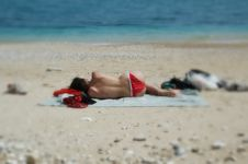 Topless Babe Takes A Nap On The Beach Stock Images