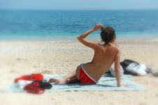 Topless Babe Sits On The Beach Royalty Free Stock Photos