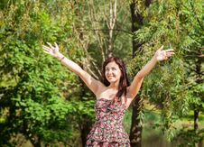 Free Young Beautiful Smiling Girl Holds Out Her Hands To The Sky Royalty Free Stock Images - 73823239