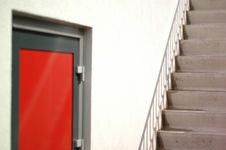 Red Door And Stairs Royalty Free Stock Image
