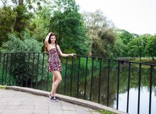 Free Beautiful Brunette Standing On The Bridge Near The River Royalty Free Stock Images - 74192069