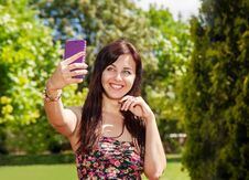 Free Girl Doing Selfie Mobile Phone In Park Royalty Free Stock Images - 74767949