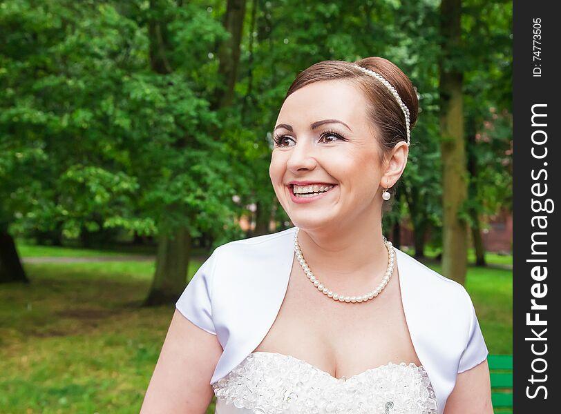 Portrait of a bride in a city park