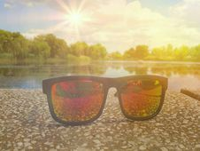 Fashionable Colorful Sunglases In A Sunny Day Stock Image