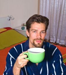Free Young Man Drinking His Morning Tea Stock Images - 7572584