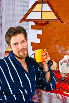 Free Young Man In Bathrobe In Kitchen Having Breakfast Royalty Free Stock Images - 7586149