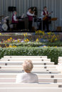 Free Lone Elderly Woman Watching Jazz Royalty Free Stock Photos - 763668
