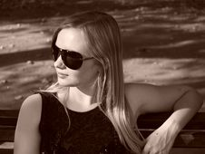 Young Woman With Sun Glasses In Sepia Royalty Free Stock Image