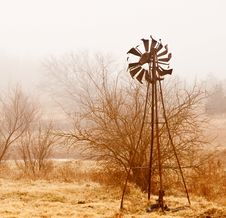 Windmill And Fog Stock Photography