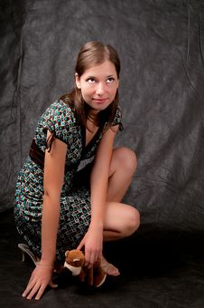 Dark Haired Girl Sitting On Hunkers Stock Photos