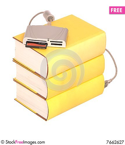Free Books With A Compact Flash Card Reader Royalty Free Stock Photography - 7662627