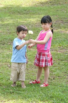 Free Girl & Boy Holding Flower Full Shot Stock Image - 772281