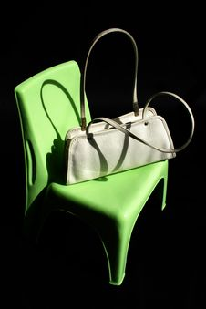 Women Handbag On Green Chair Stock Images