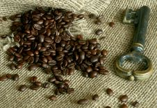 Free Grains Of Coffee And An Old Key On  Sacking Stock Images - 7704154