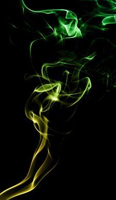 Yellow-Green Smoke On Black Royalty Free Stock Photo