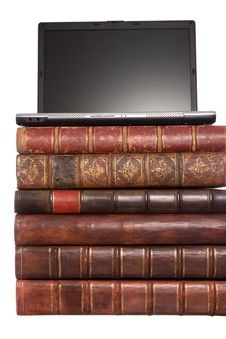 Old Leather Bound Books With A Laptop Royalty Free Stock Photos