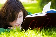 Free Woman Reading On Grass Stock Photos - 7708533