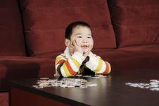 Boy Playing Jigsaw Puzzle Royalty Free Stock Image