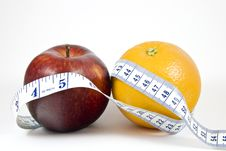 Free Apple And Orange Wrapped By Tape Measure Stock Photos - 7710723