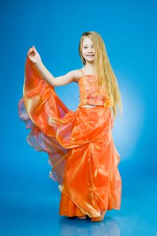 Free Smiling Little Girl In Orange Dress Stock Photography - 7711942
