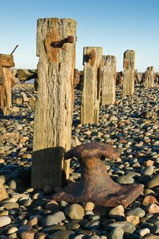 Groynes And Rusty Bollard Royalty Free Stock Image