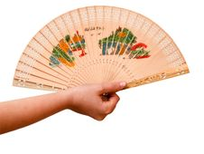 Girl S Hand Holding A Pink Fan Royalty Free Stock Photos