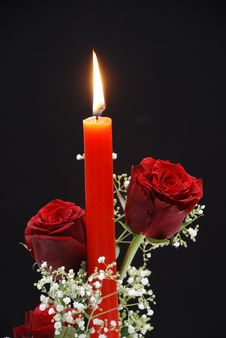 Red Roses With Candle Stock Image