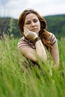 Free Beautiful Girl Lying Down Of Grass Royalty Free Stock Photography - 7717247