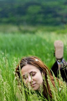 Free Beautiful Girl Lying Down Of Grass Stock Image - 7717351
