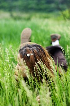 Free Beautiful Girl Lying Down Of Grass Stock Image - 7717431