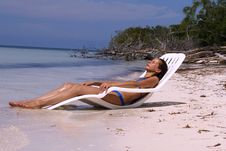 Free Woman Relaxing On The Beach Stock Photo - 7717630