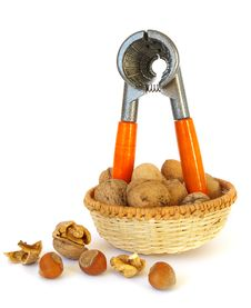 Walnuts And Nutcracker Stock Images